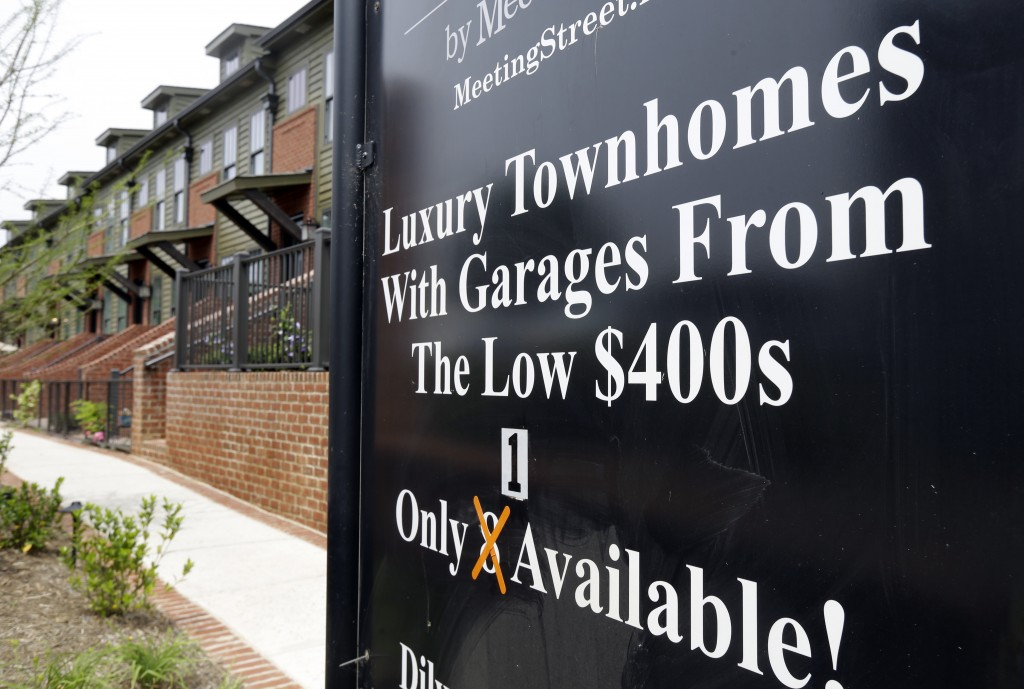 FILE - This Thursday, April 27, 2017, file photo shows a sign promoting town homes for sale, in Charlotte, N.C. A healthy demand for homes and a shrin...