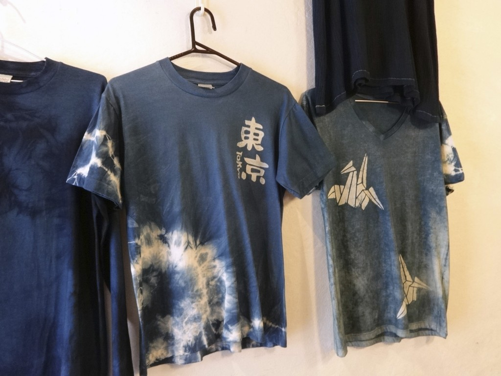 This Nov. 14, 2017 photo shows indigo dyed products for sale at Wanariya workshop in Tokyo. (Linda Lombardi via AP)