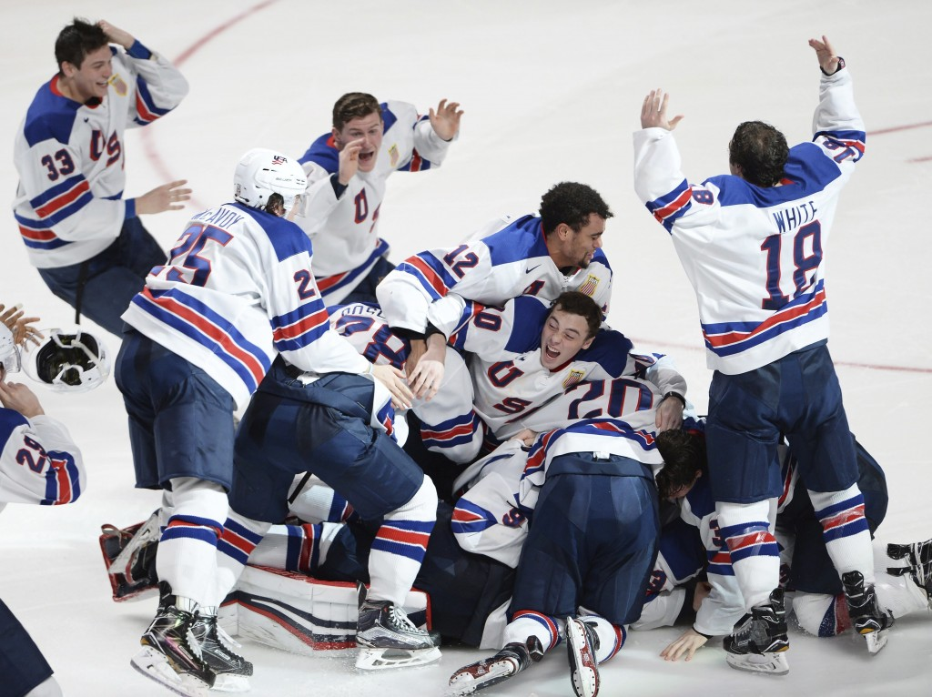 FILE - In this Jan. 5, 2017, file photo, United States players celebrate their victory over Canada in the final of the world junior championship in Mo...