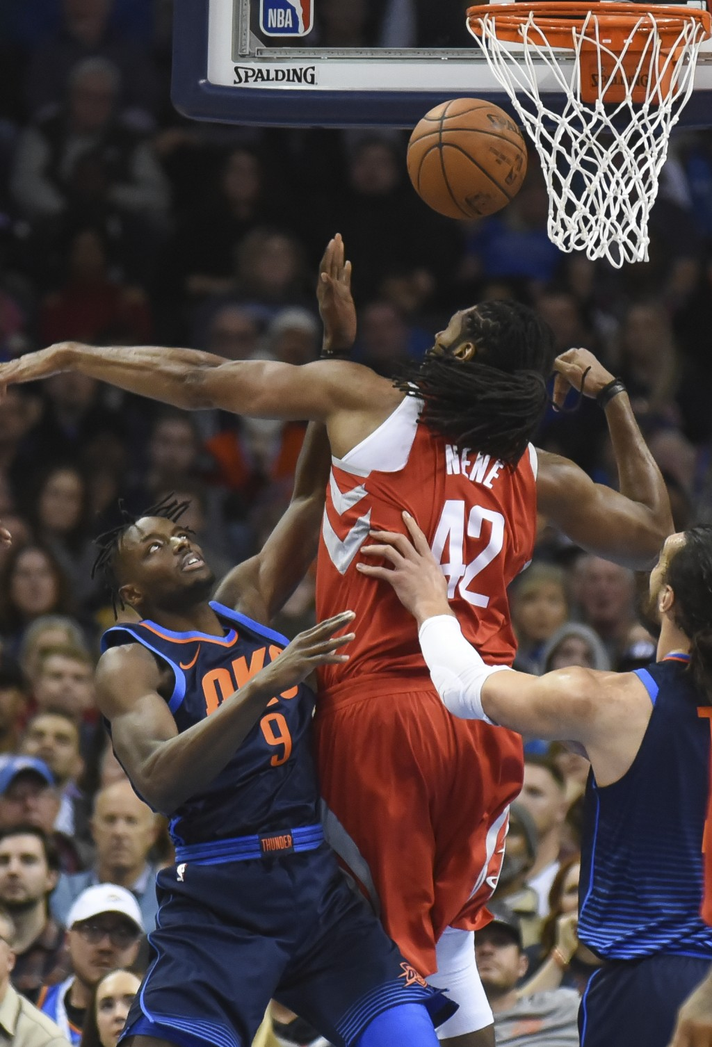 Oklahoma City Thunder's Jerami Grant (9) shoots the ball over Houston Rockets' Nene (42) in the first quarter of an NBA basketball game in Oklahoma Ci...