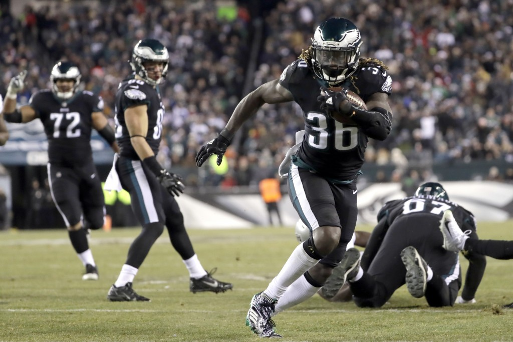 Philadelphia Eagles' Jay Ajayi (36) runs for a touchdown during the first half of an NFL football game against the Oakland Raiders, Monday, Dec. 25, 2...