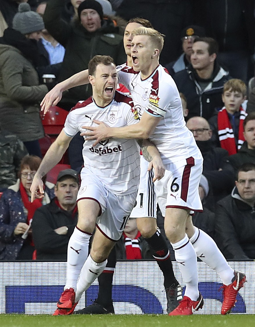 Burnley's Ashley Barnes, left, celebrates scoring his side's first goal of the game during the English Premier League soccer match against Manchester ...