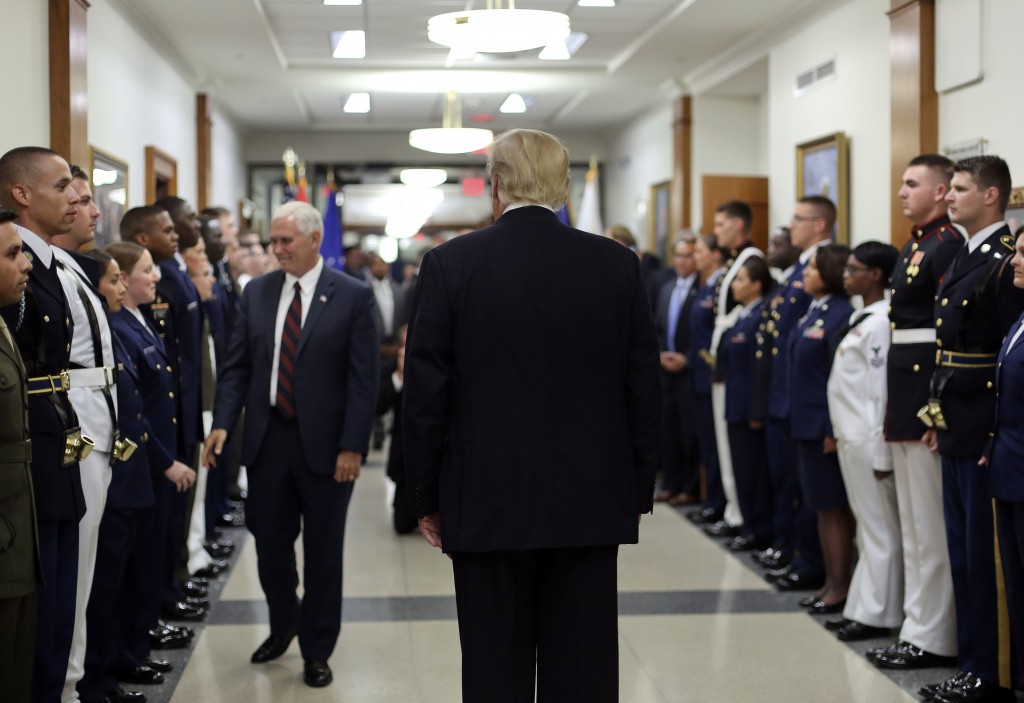 FILE - In this July 20, 2017, file photo, President Donald Trump and Vice President Mike Pence greet military personnel during their visit to the Pent...