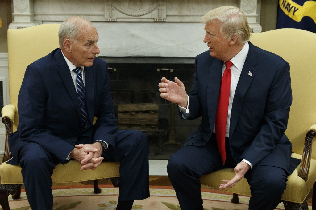 FILE - In this July 31, 2017, file photo, President Donald Trump talks with new White House Chief of Staff John Kelly after he was privately sworn in ...