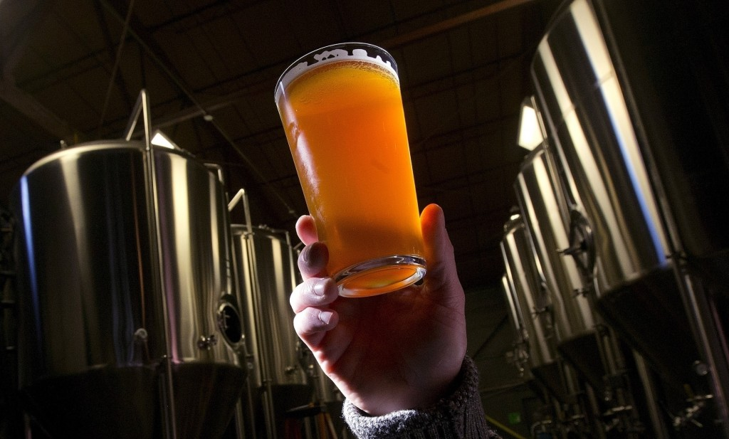 FILE - This Dec. 11, 2013, file photo, shows a beer at a microbrewery in Birmingham, Ala. Craft breweries are raising a glass to the Republicans' new ...