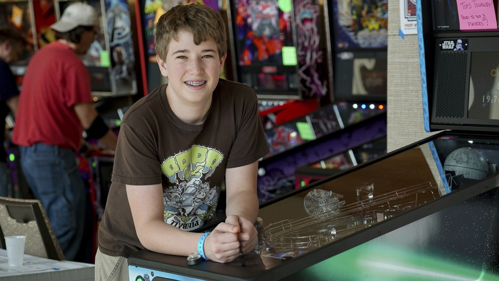 In this Oct. 13, 2017 photo, Escher Lefkoff poses for a photo at the Pinball Expo 2017 in Chicago. Lefkoff won the Professional and Amateur Pinball As...