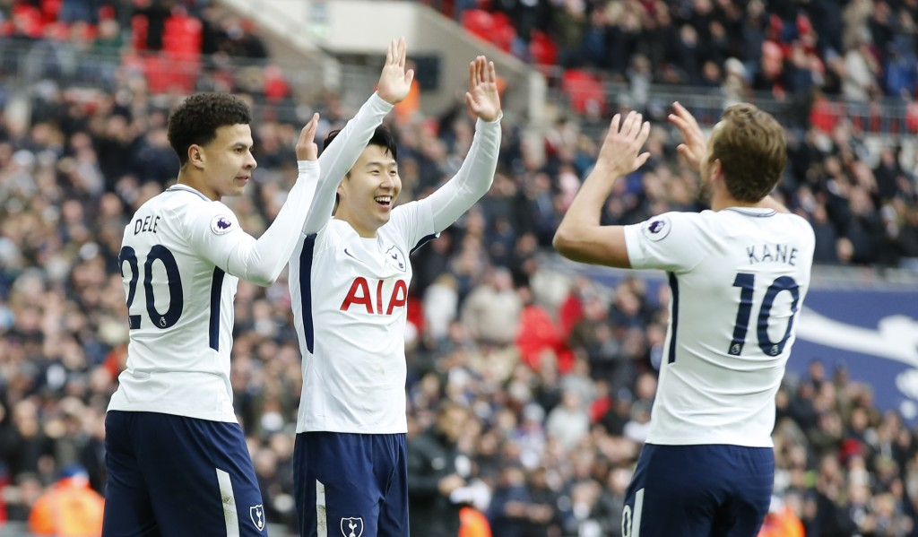 Tottenham Hotspur's Son Heung-min, centre, celebrates with teammate Tottenham Hotspur's Dele Alli, right and Tottenham Hotspur's Harry Kane after he s...