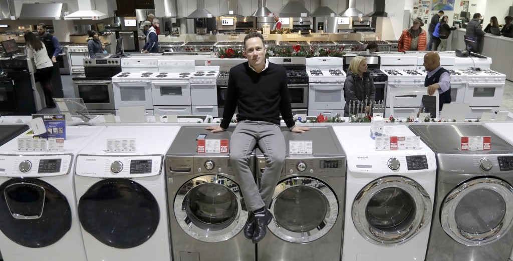 In this Wednesday, Dec. 20, 2017, photo, Jon Abt poses for a portrait on the sales floor of the Abt family's single appliance and furniture store in G...
