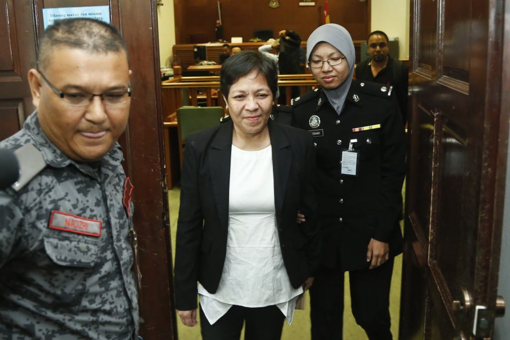 Australian Maria Elvira Pinto Exposto, center, leaves her hearing at the Shah Alam High Court after being found not guilty in Shah Alam, Malaysia, Wed...
