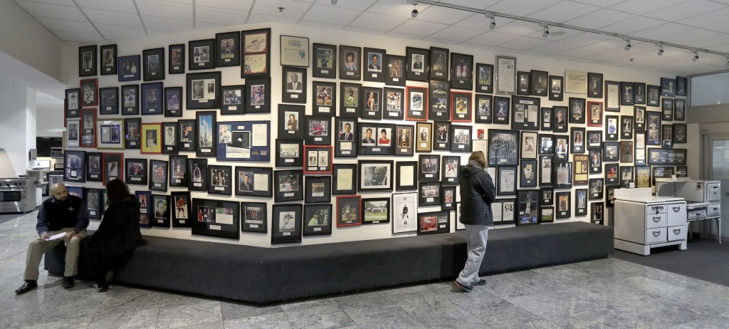 This Wednesday, Dec. 20, 2017, photo, shows a wall of photos of local and national celebrities who have made purchases with the Abt electronic, applia...