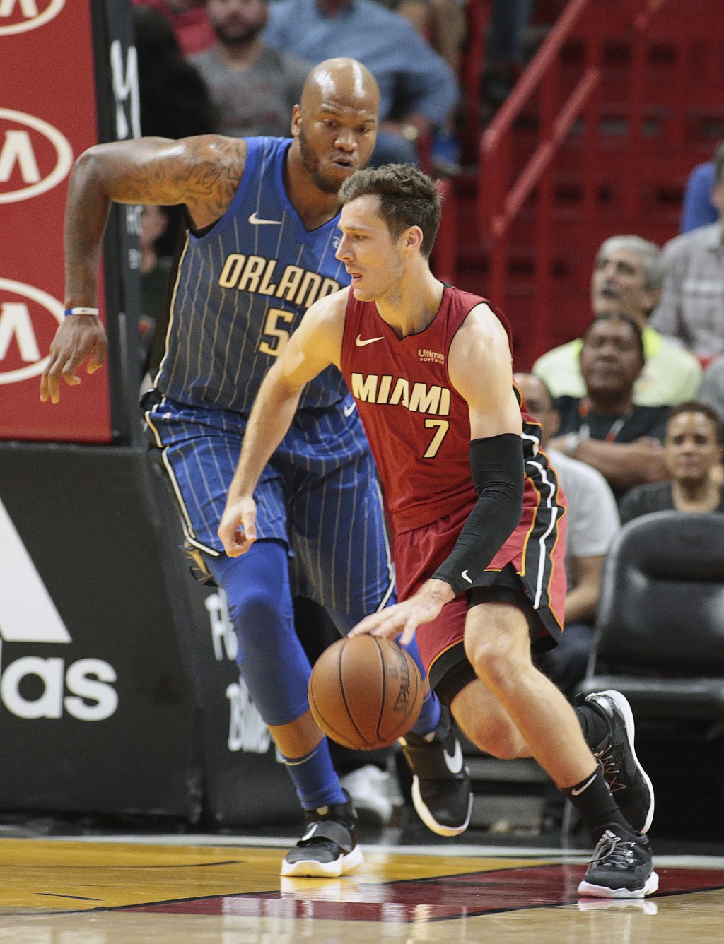 Orlando Magic forward Marreese Speights (5) defends against Miami Heat guard Goran Dragic (7) during the first half of an NBA basketball game, Tuesday...