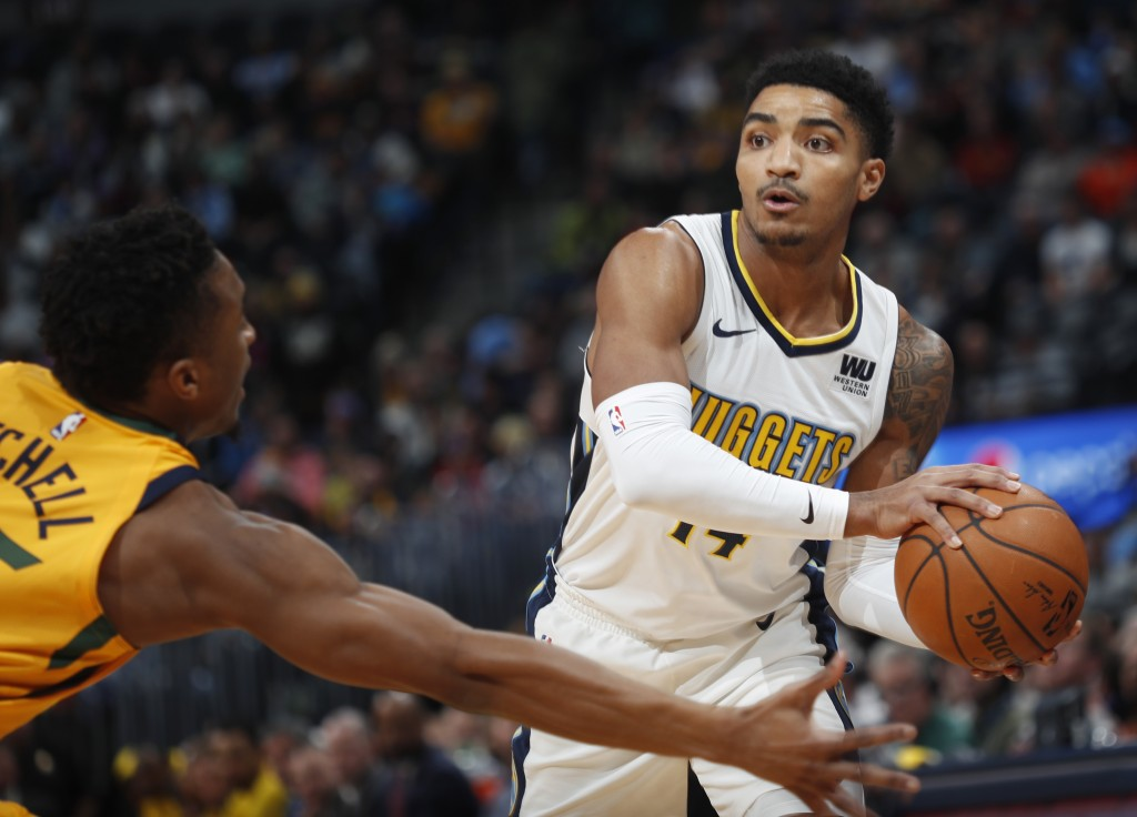 Denver Nuggets guard Gary Harris, right, looks to pass the ball as Utah Jazz guard Donovan Mitchell defends in the first half of an NBA basketball gam...