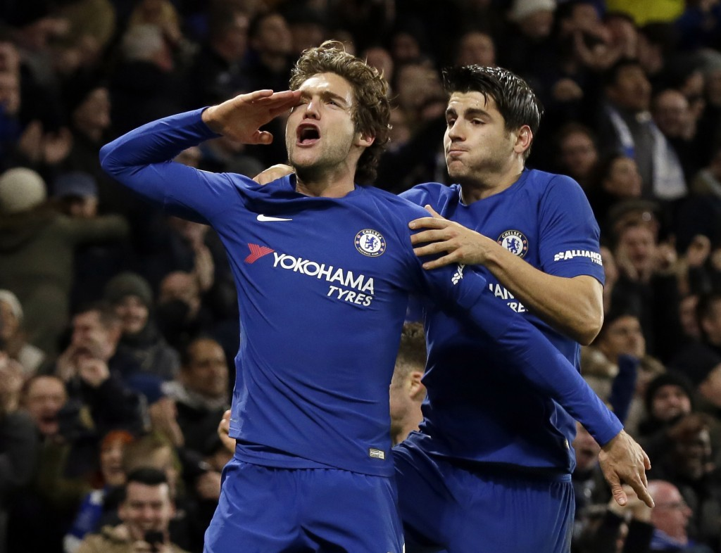 Chelsea's Marcos Alonso, left, celebrates after scoring a goal with teammate Alvaro Morata during the English Premier League soccer match between Chel...