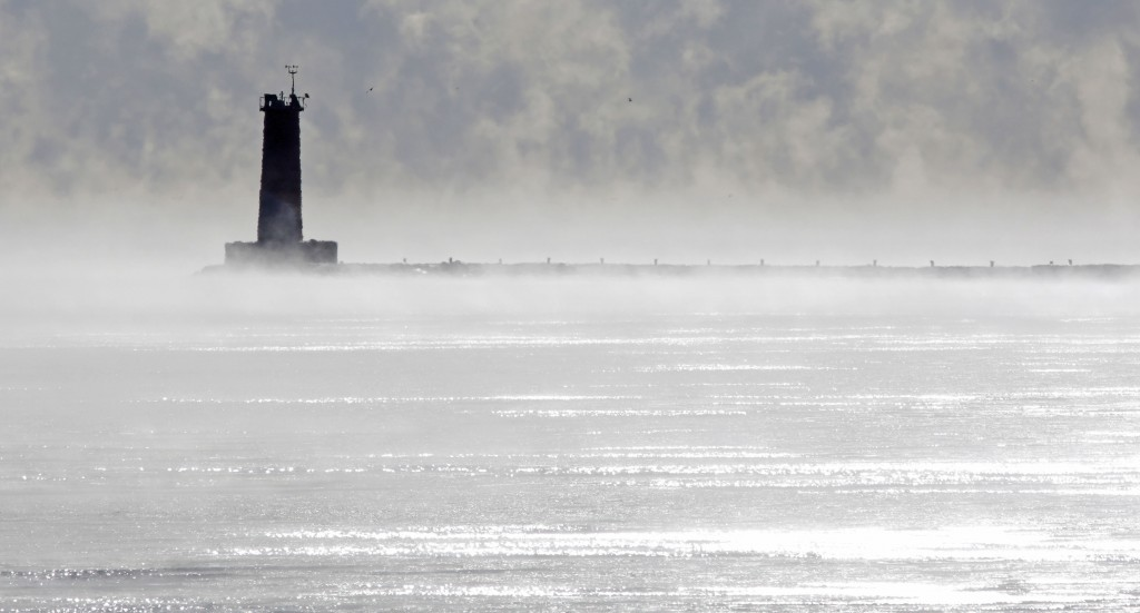 The Sheboygan lighthouse looks lonely among the steam rising from Lake Michigan due to the cold morning temperatures, Tuesday Dec. 26, 2017, at Sheboy...