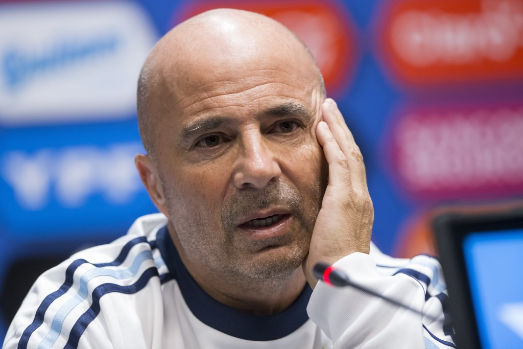 FILE - In this Friday, Nov. 10, 2017 filer, Argentina coach Jorge Sampaoli speaks to the media after his team's training session ahead of their friend...
