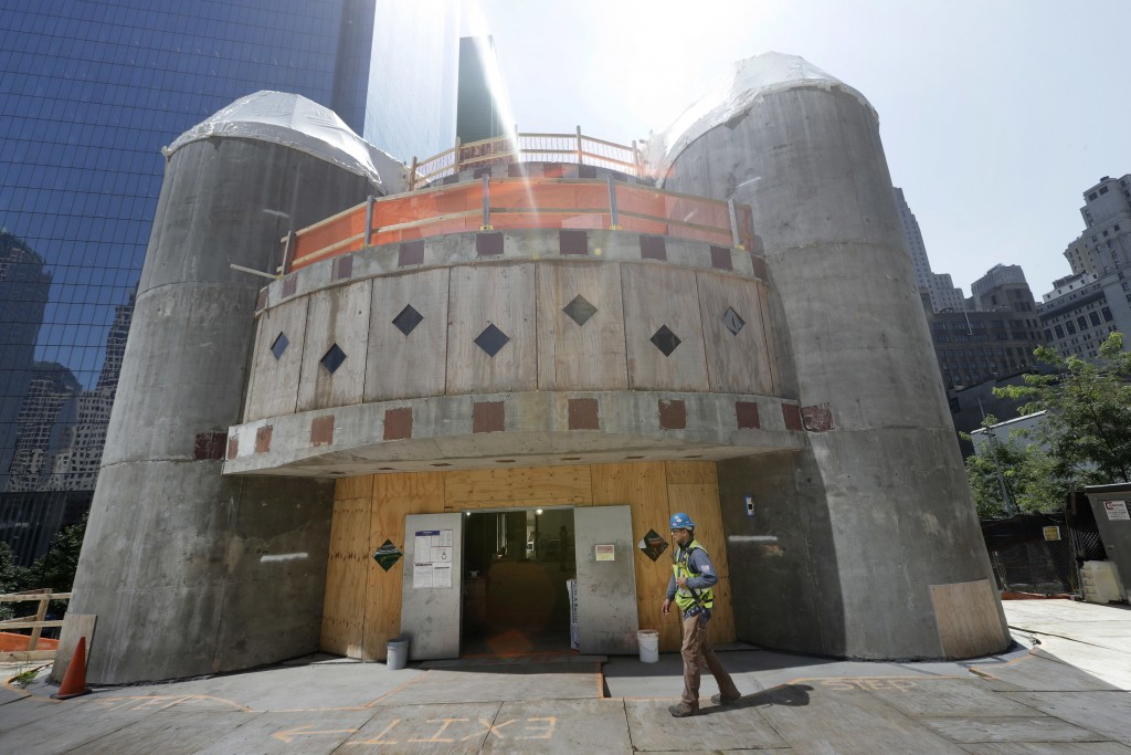 FILE- In this Aug. 10, 2017 file photo, a construction worker walks in front of the St. Nicholas National Shrine in New York. Work on the Greek Orthod...