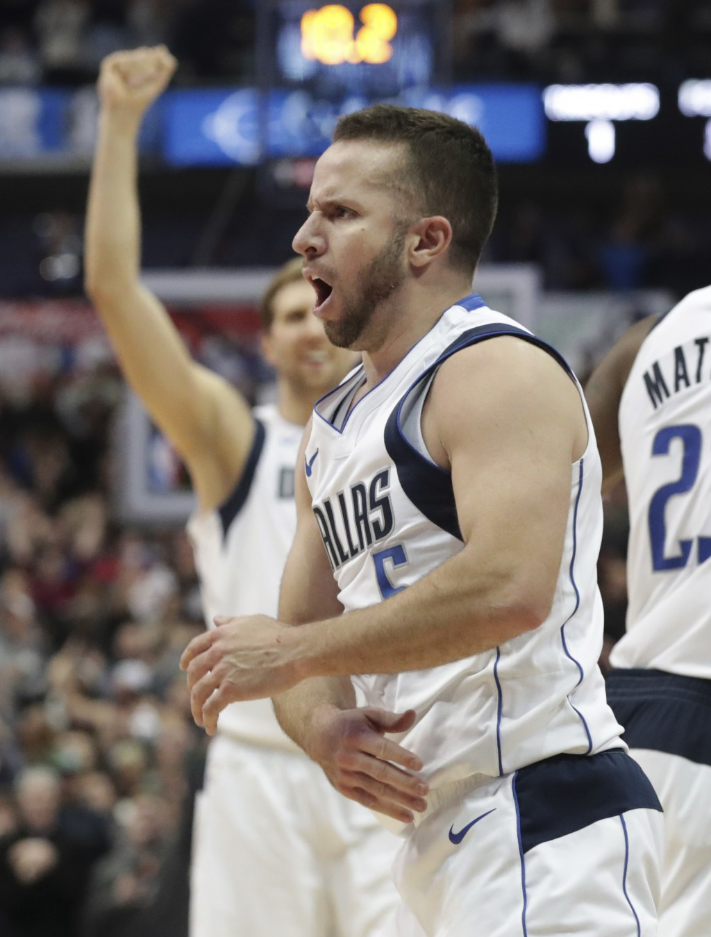 Dallas Mavericks guard J.J. Barea (5) reacts to scoring during the second half of an NBA basketball game against the Toronto Raptors in Dallas, Tuesda...