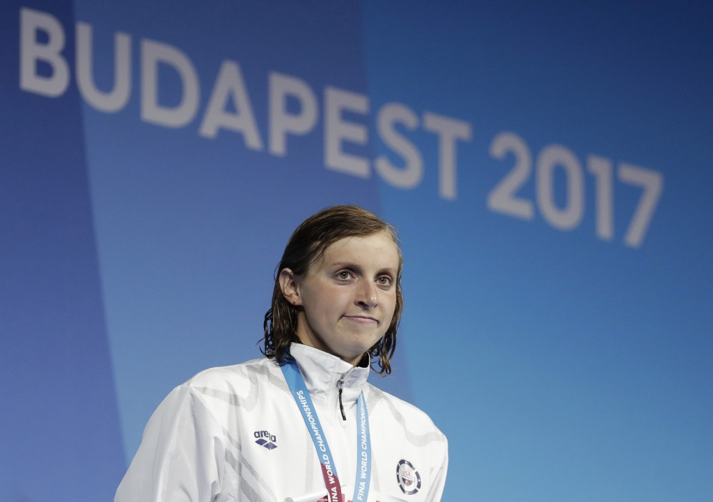 FILE - In this July 23, 2017, file photo, United States' gold medal winner Katie Ledecky smiles during the ceremony for the women's 400-meter final du...
