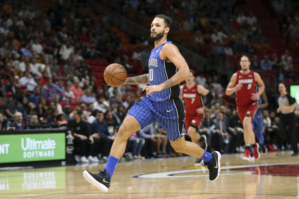 Orlando Magic forward Evan Fournier (10) dribbles the ball up court against the Miami Heat during the first half of an NBA basketball game, Tuesday, D...