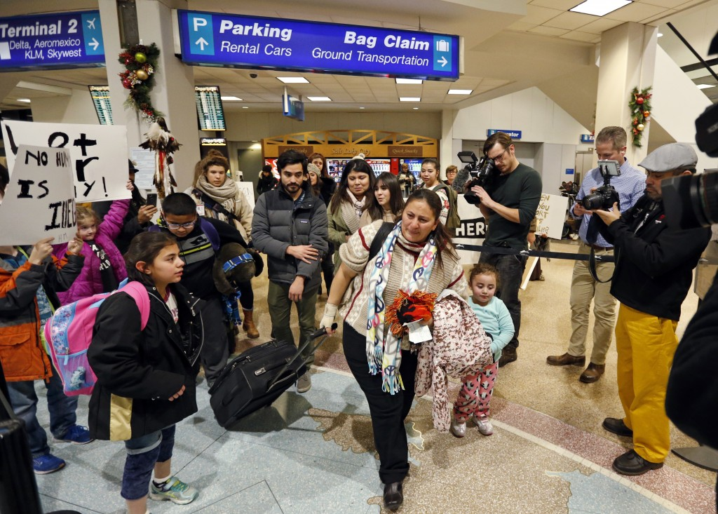 In this Monday, Dec. 25, 2017, photo, Maria Santiago Garcia, and her children walk to the security gate at the Salt Lake City International Airport. G...