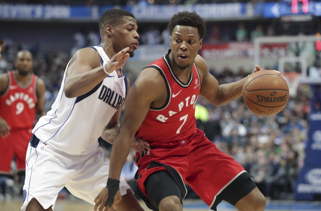 Toronto Raptors guard Kyle Lowry (7) dribbles against Dallas Mavericks guard Dennis Smith Jr. during the first half of an NBA basketball game in Dalla...