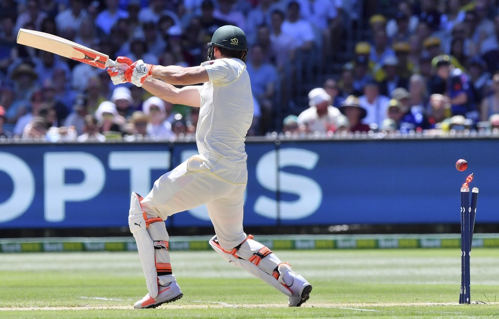 Australia's Mitchell Marsh is bowled by England's Chris Woakes for 9 runs during the second day of their Ashes cricket test match in Melbourne, Austra...