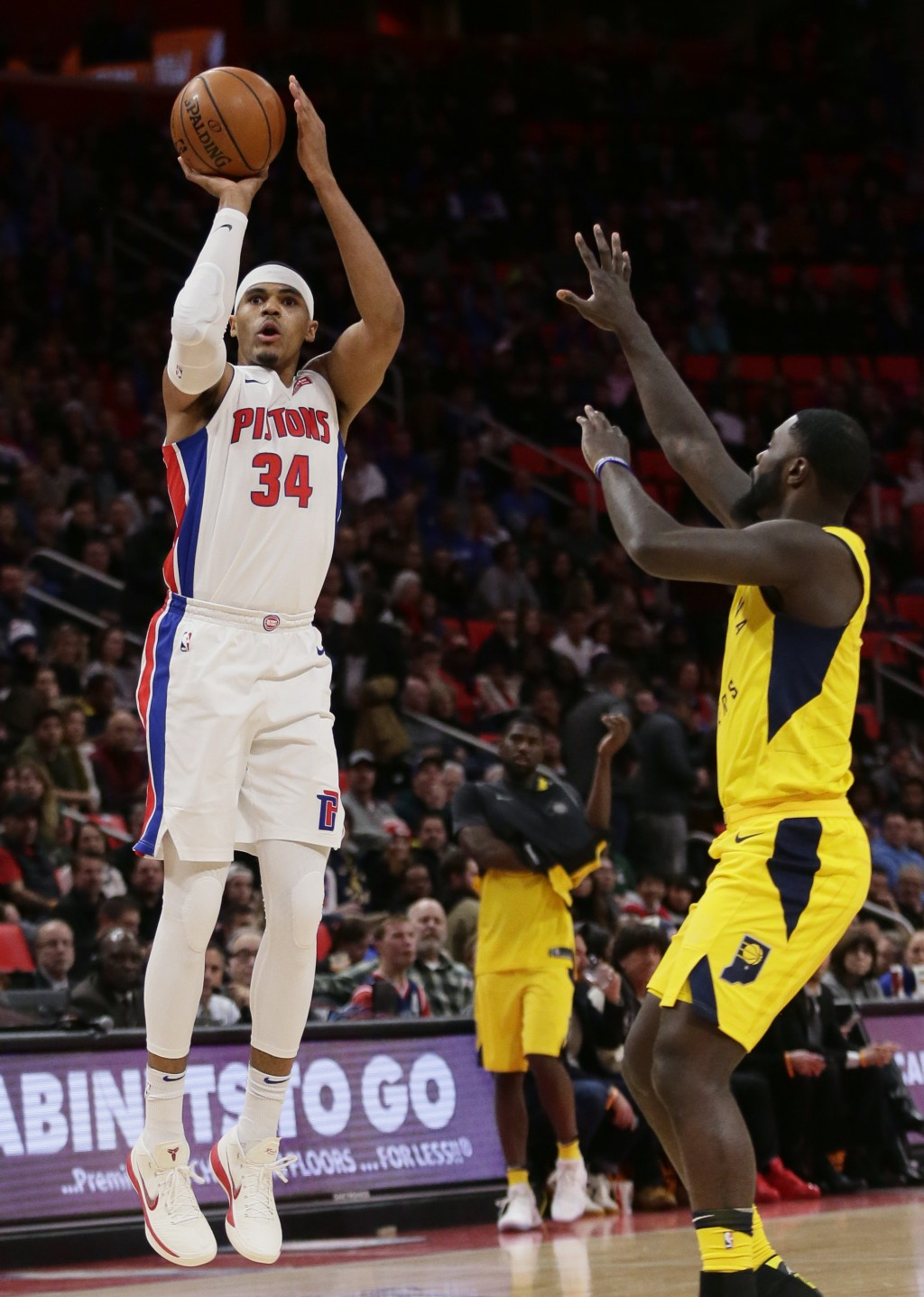 Detroit Pistons forward Tobias Harris (34) takes a shot against Indiana Pacers guard Lance Stephenson during the first half of an NBA basketball game,...