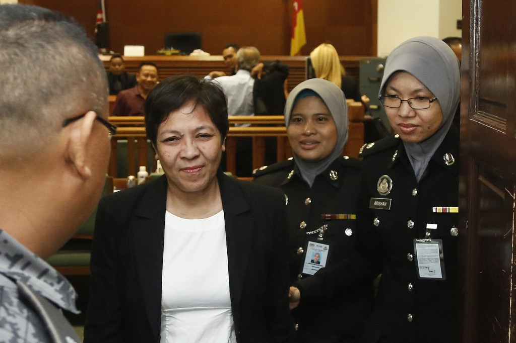 Australian Maria Elvira Pinto Exposto leaves her hearing at the Shah Alam High Court after being found not guilty in Shah Alam, Malaysia, Wednesday, D...