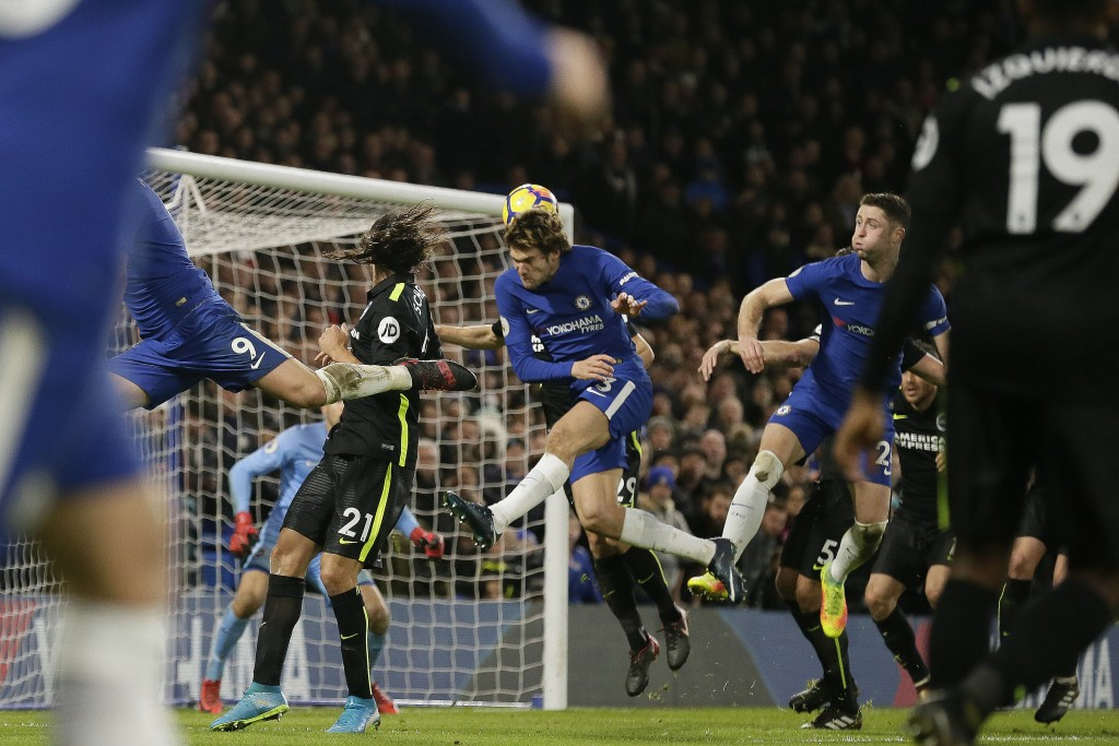 Chelsea's Marcos Alonso, centre, scores a goal during the English Premier League soccer match between Chelsea and Brighton & Hove Albion at Stamford B...