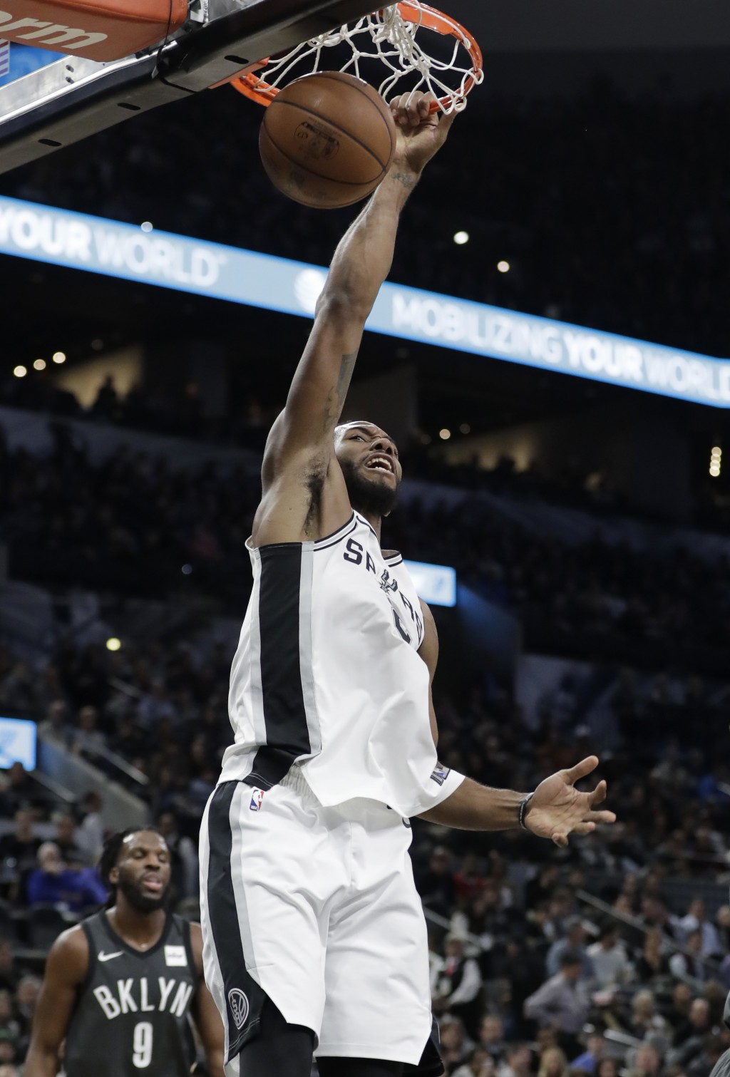San Antonio Spurs forward Kawhi Leonard scores against the Brooklyn Nets during the first half of an NBA basketball game, Tuesday, Dec. 26, 2017, in S...