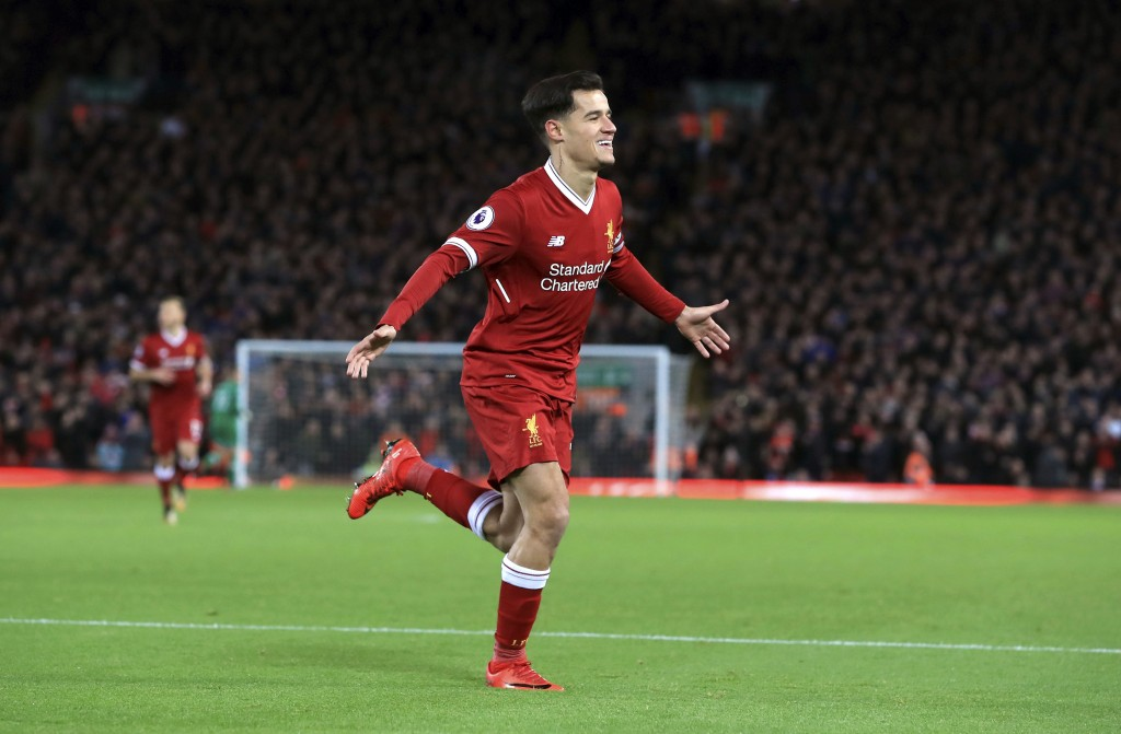 Liverpool's Philippe Coutinho celebrates scoring his side's first goal of the game against Swansea City during the English Premier League soccer match...