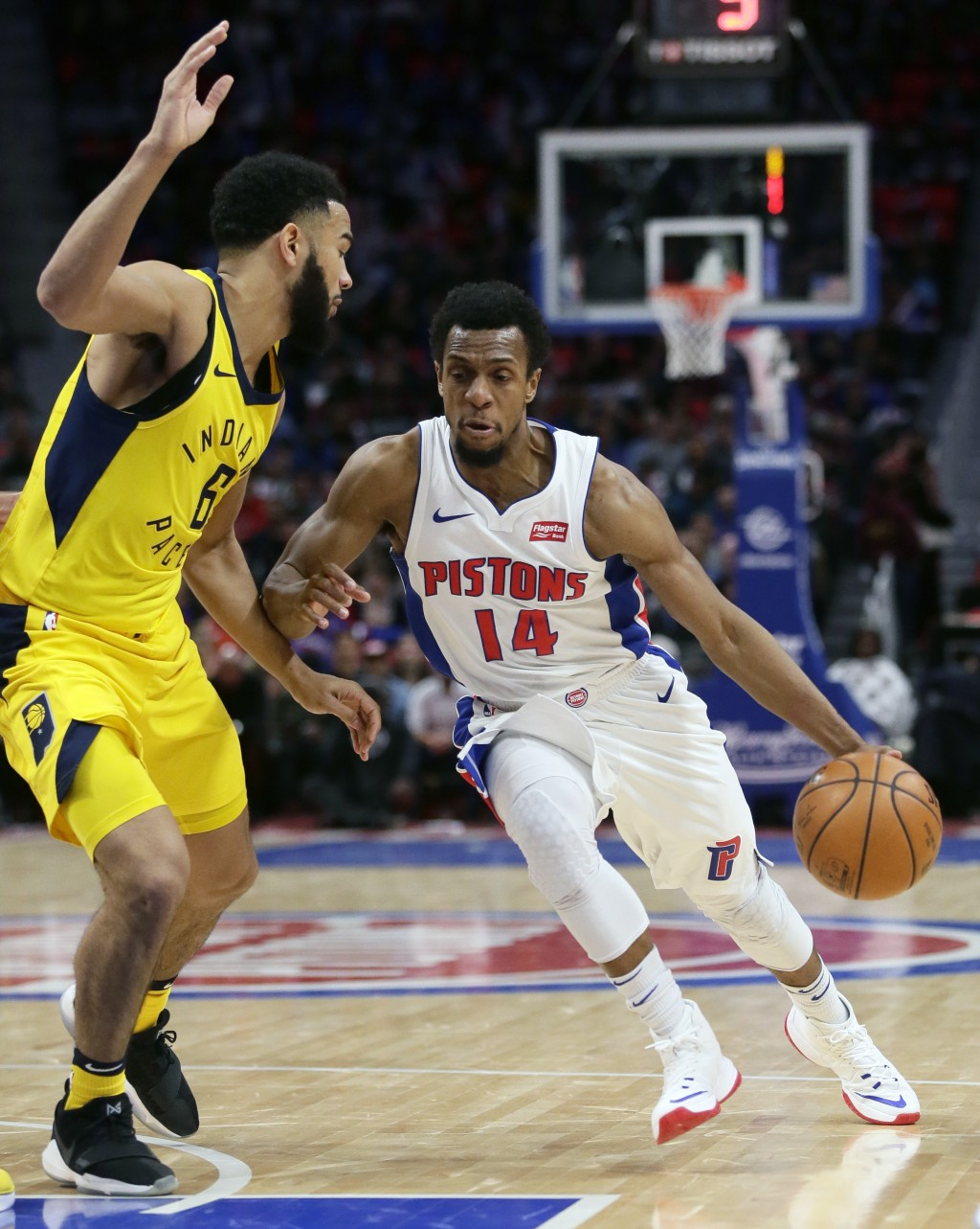 Detroit Pistons guard Ish Smith (14) drives to the basket against Indiana Pacers guard Cory Joseph (6) during the first half of an NBA basketball game...