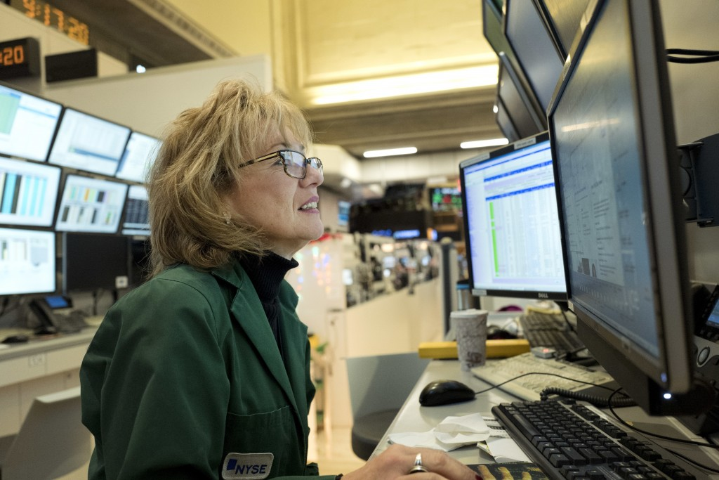 Maria Averna, a lead supervisor for New York Stock Exchange Operations, monitors trading at the exchange, Wednesday, Dec. 27, 2017. (AP Photo/Mark Len...