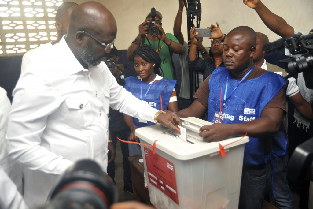 Former soccer star George Weah, Presidential candidate for the Coalition for Democratic Change, casts his vote during a Presidential runoff election i...