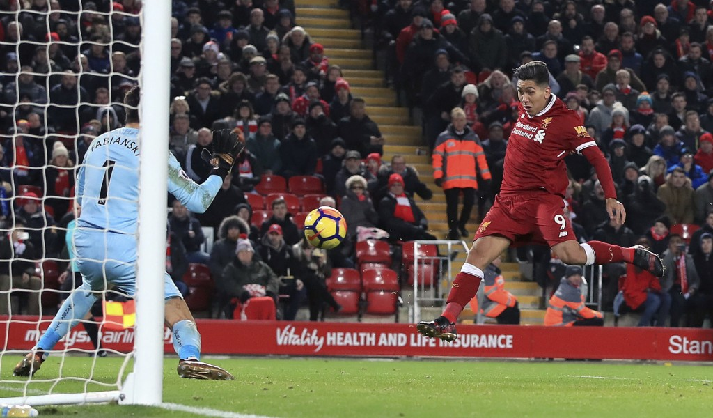 Liverpool's Roberto Firmino scores his side's second goal of the game against Swansea City during the English Premier League soccer match at Anfield, ...