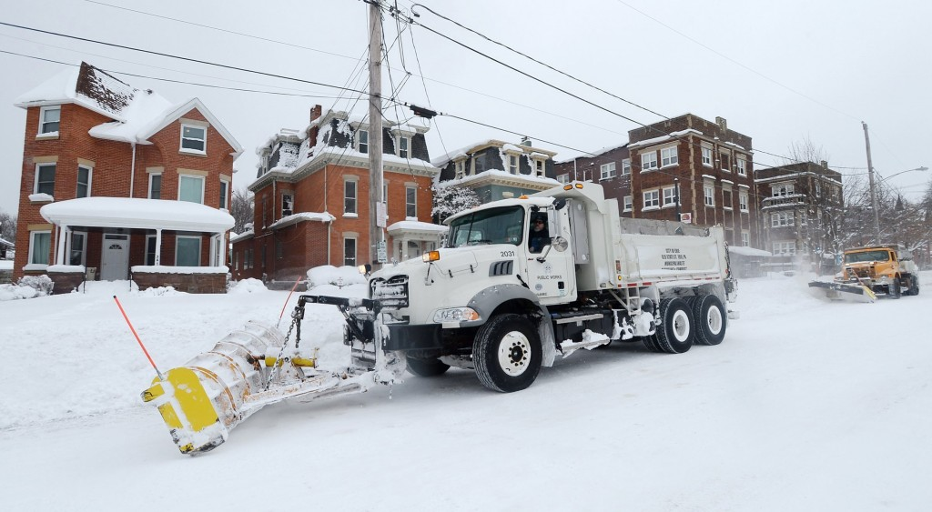 Workers from the City of Erie clear snow after a record snowfall on Tuesday, Dec. 26, 2017, in Erie, Pa. The National Weather Service office in Clevel...
