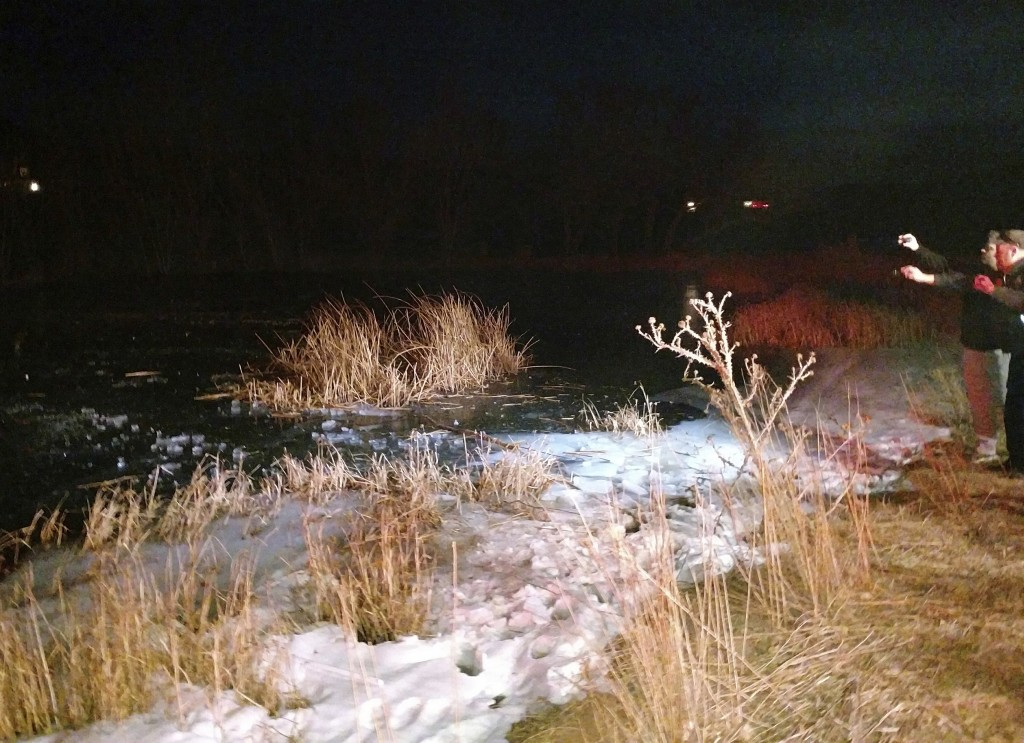 In this Monday, Dec. 25, 2017 photo provided by the Washington County Sheriffs Office, a search and rescue team work on the edge of a frozen pond in t...
