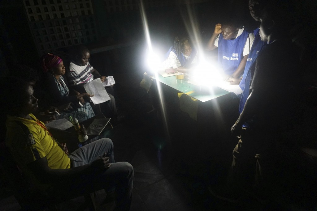 Election officials count ballot papers after a Presidential runoff election in Monrovia, Liberia. Tuesday Dec. 26, 2017.  Young Liberians went straigh...