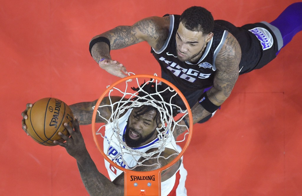LA Clippers center DeAndre Jordan shoots past Sacramento Kings guard Frank Mason III during the first half of an NBA basketball game in Los Angeles, T...