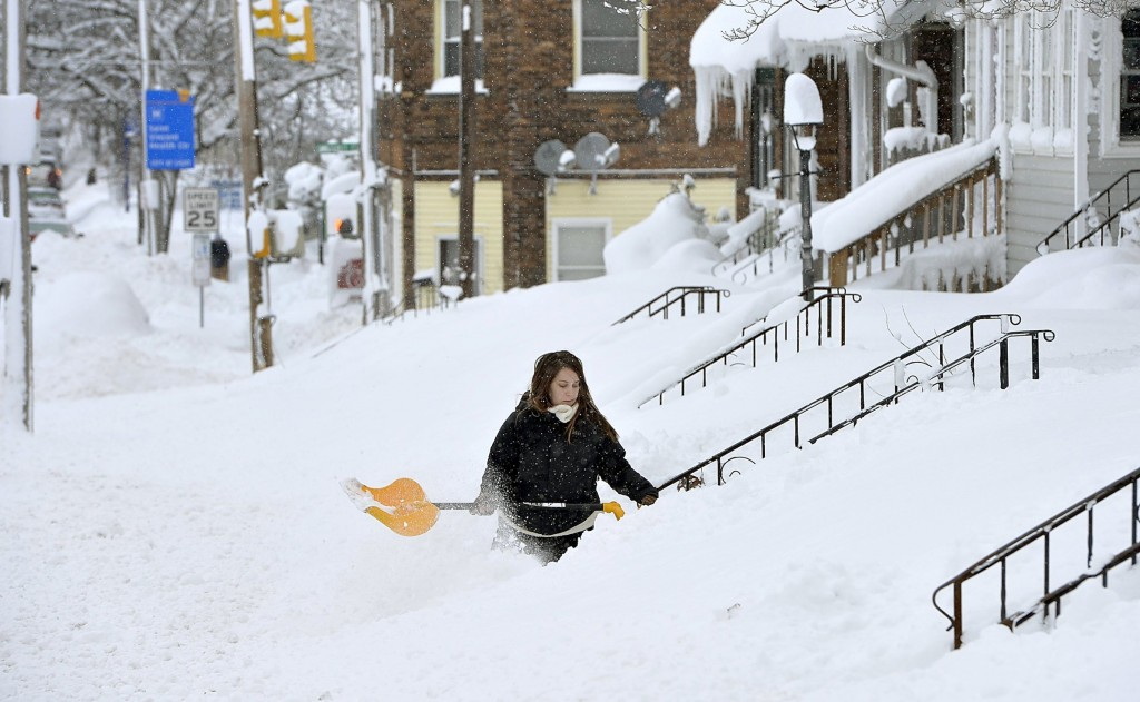 Rochelle Carlotti, 28, shovels steps near her home after a record snowfall on Tuesday, Dec. 26, 2017, in Erie, Pa. The National Weather Service office...