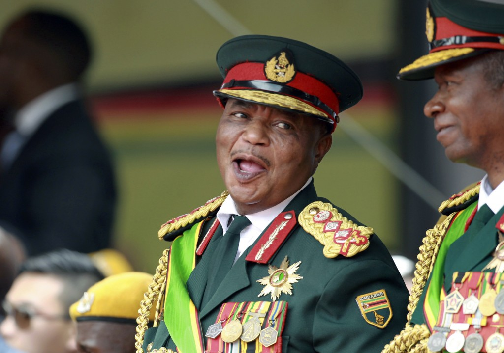 FILE - In this Friday, Nov. 24, 2017 file photo, Army General Constantino Chiwenga smiles during the presidential inauguration ceremony in the capital...