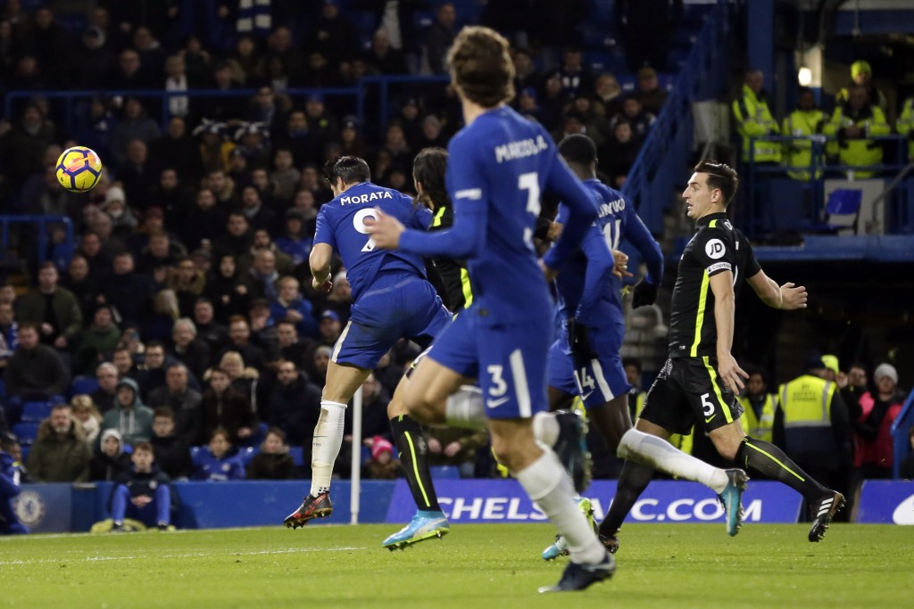 Chelsea's Alvaro Morata, left, scores a goal during the English Premier League soccer match between Chelsea and Brighton & Hove Albion at Stamford Bri...