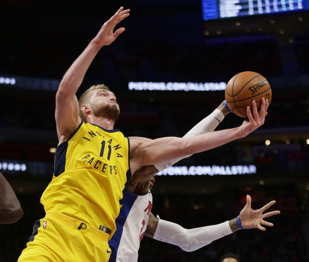 Indiana Pacers center Domantas Sabonis (11) grabs a rebound against Detroit Pistons forward Eric Moreland during the first half of an NBA basketball g...