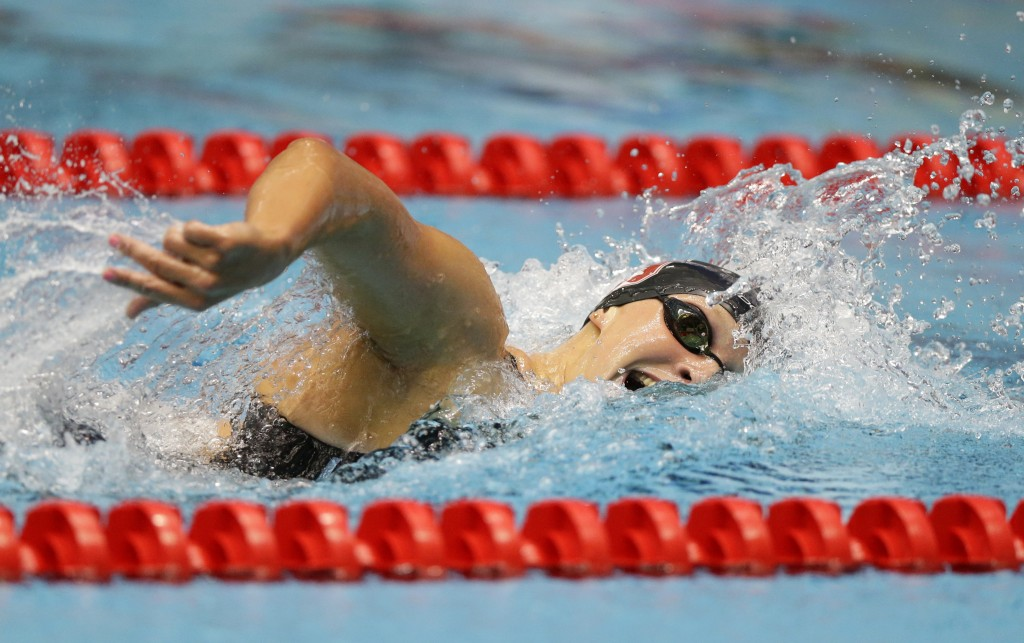 FILE - In this June 27, 2017, file photo, Katie Ledecky swims on her way to winning the women's 800-meter freestyle at the U.S. swimming championships...