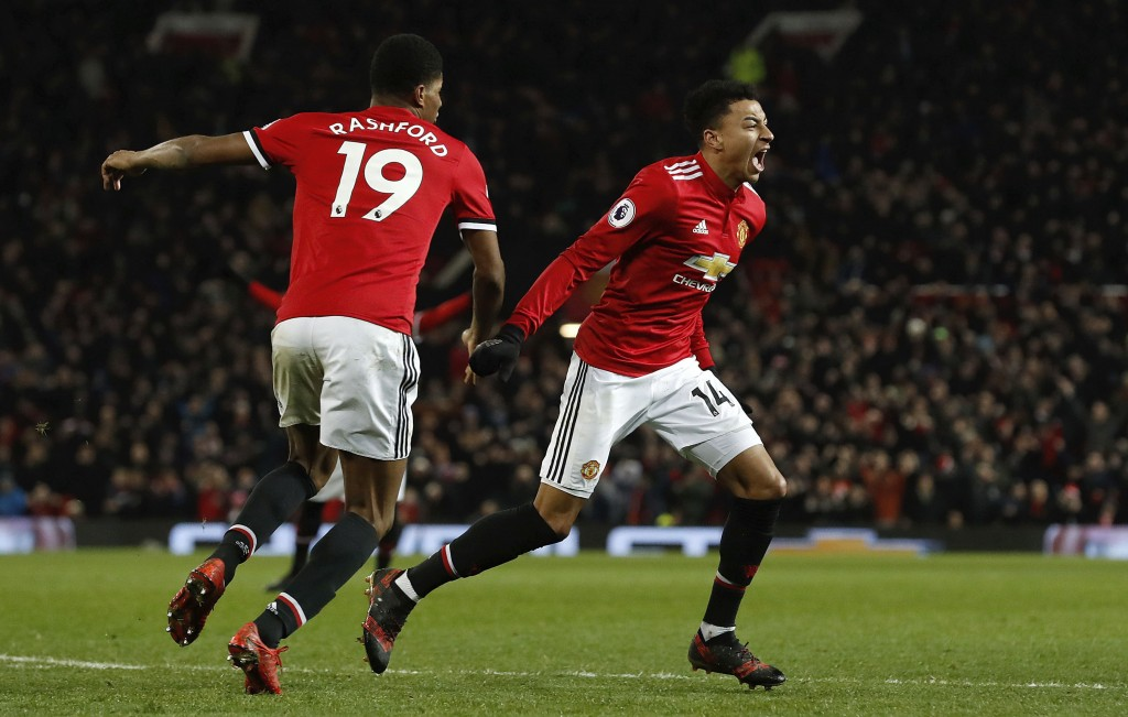 Manchester United's Jesse Lingard, right, celebrates scoring his side's second goal during their English Premier League soccer match against Burnley a...