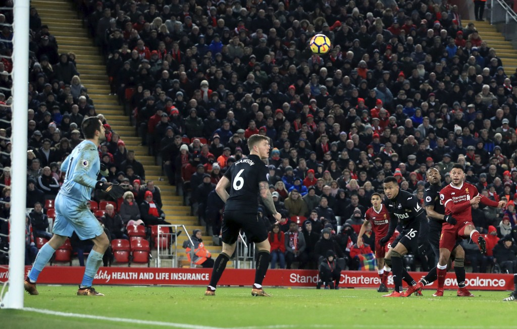 Liverpool's Alex Oxlade-Chamberlain, right, scores his side's fifth goal of the game against Swansea City during the English Premier League soccer mat...