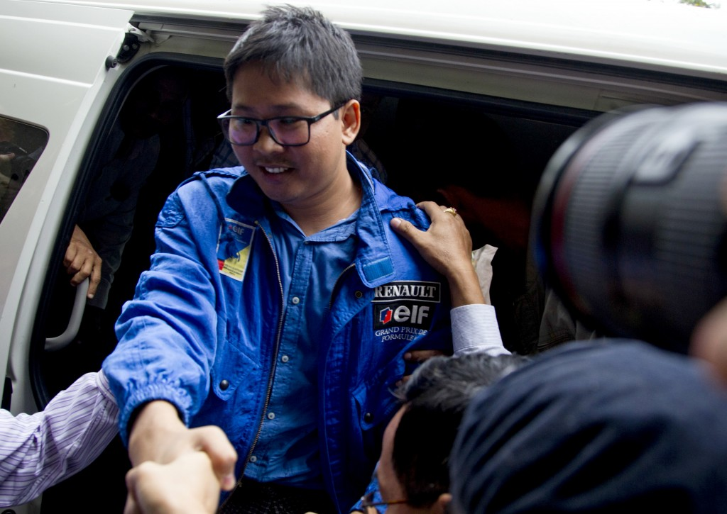 In this Dec. 27, 2017, file photo, Reuters journalist Thet Oo Maung, known as Wa Lone, exits a police van as he arrives for a court appearance, outsid