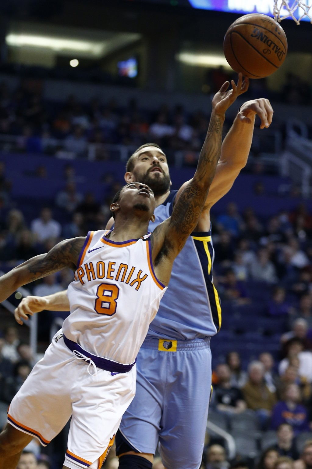 Phoenix Suns guard Tyler Ulis (8) gets his shot blocked by Memphis Grizzlies center Marc Gasol (33) during the first half of an NBA basketball game, T...