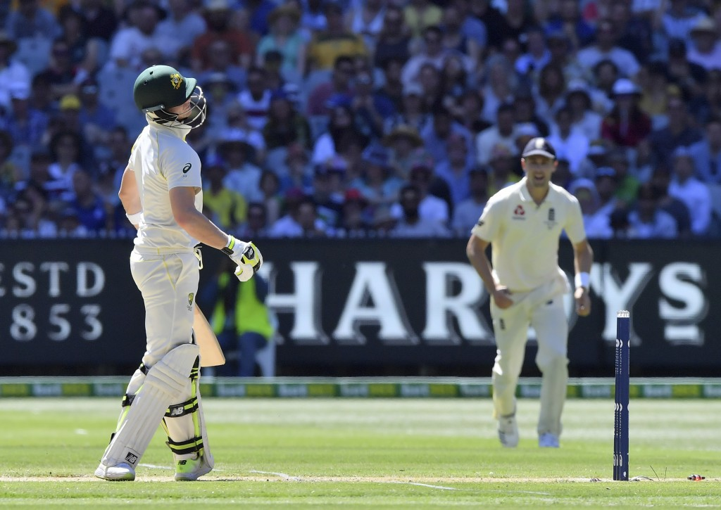 Australia's Steve Smith, left, tilts his head after chopping on and losing his wicket for 76 runs to England during the second day of their Ashes cric...