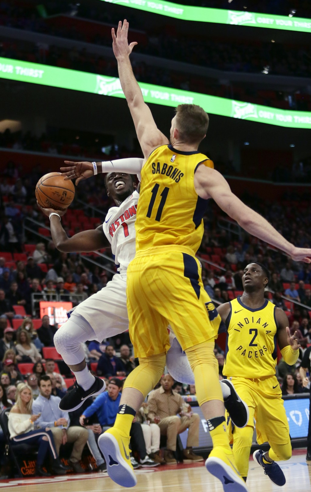 Detroit Pistons guard Reggie Jackson (1) takes a shot against Indiana Pacers center Domantas Sabonis (11) during the first half of an NBA basketball g...